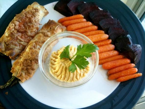Dinner time! Glazed carrots, roasted beets, phyllo asparagus rolls, and fresh spicy garlic hummus!