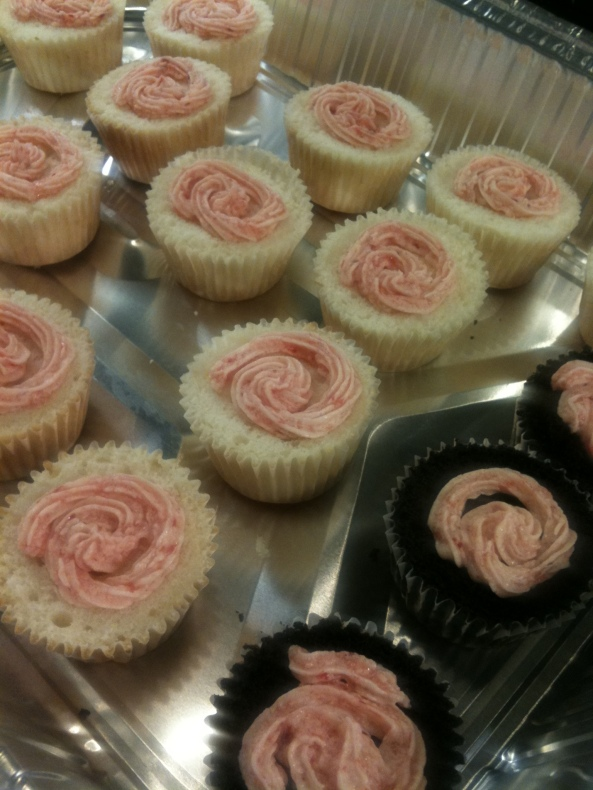 home made strawberry butter cream to fill the cupcakes :)