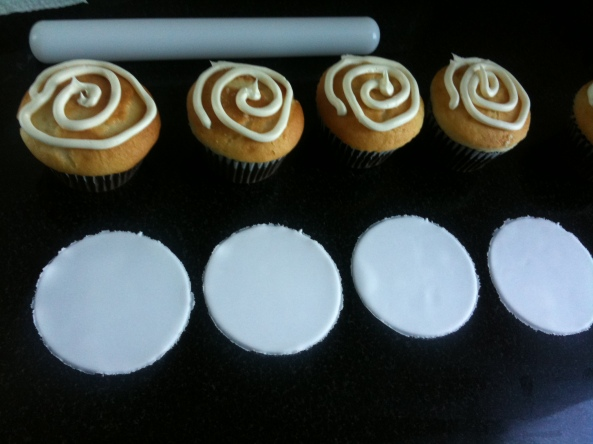 """dirty iced"" cupcakes with fondant circles. (of course, I had to spread the icing before applying the circles... but I like to swirl it on first... :) )"
