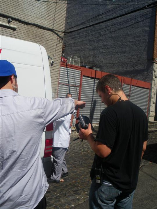 Filming is taking place! That guy behind the crew's arm is Buddy, loading a cake into the truck... A few other people and myself stick around, and a girl from Montreal asks if he can come back out to take a few pictures. He says he'll be out in 2 minutes...